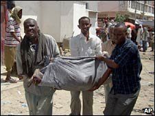 Relatives carry one of the victims of the blasts in Mogadishu.  Photo: 1 May 2010