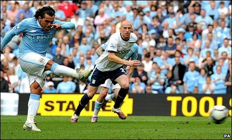 Carlos Tevez (left) equalises for Manchester City from the penalty spot