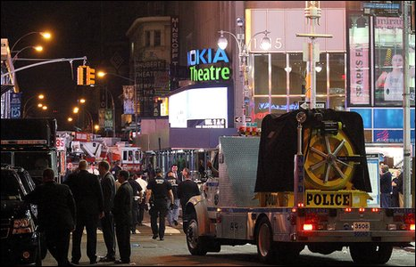 A police vehicle moves along 44th street near Times Square in New York Sunday, May 2, 2010, as an investigation into an improvised car bomb gets underway