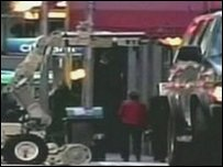 Bomb disposal robot approaches vehicle in Times Square