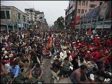 Maoists supporters shout slogans as they block road in Katmandu, Nepal, Sunday, May 2, 2010.