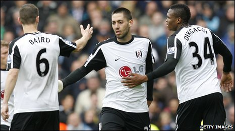Clint Dempsey (centre) is congratulated by teammates Chris Baird and Kagisho Dikgacoi