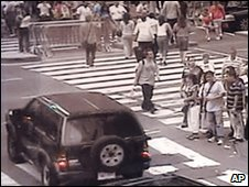 Still photo from a CCTV camera shows the Nissan Pathfinder (bottom left) passing through Times Square