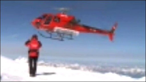 Helicopter landing in the Alps