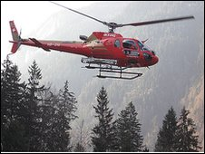 Helicopter carries skiers up to Swiss Alps
