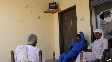 Pakistani villagers watch breaking news on the Indian court verdict against alleged surviving gunman of the Mumbai massacre, Mohammed Ajmal Amir Kasab, at a house in the remote town of Faridkot on May 3, 2010