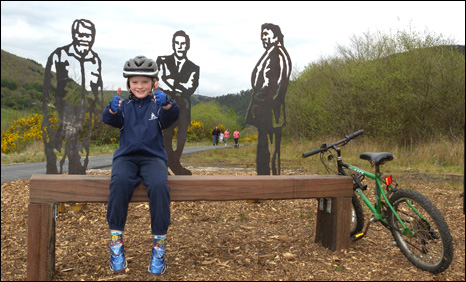 Cyclist Sebastion next to the sculpture