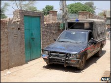Pakistani policemen patrol at the assumed house of the alleged surviving gunman of the Mumbai massacre, Mohammed Ajmal Amir Kasab in the remote town of Faridkot on May 3, 2010