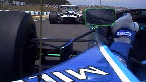 Damon Hill gets past Michael Schumacher