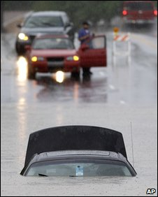 A submerged car sits in flood waters in Nashville, Tennessee