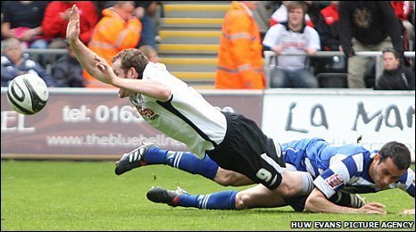 Craig Beattie is brought down by Doncaster's Sam Hird