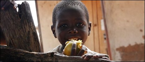 child eating a fruit