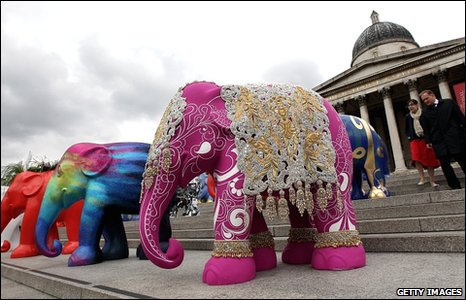 Decorative model elephants stand in Trafalgar Square for a photocall