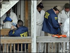 FBI agents search an apartment in Bridgeport, Connecticut