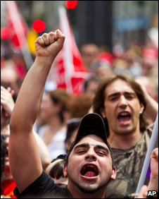 Demonstrators shout slogans during a Labour Day march in Madrid