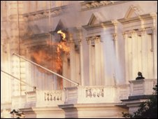 A grenade explodes on the embassy balcony