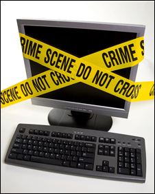 Computer with police tape on it