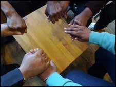 Women holding hands at the Crossroads Women's Centre in London