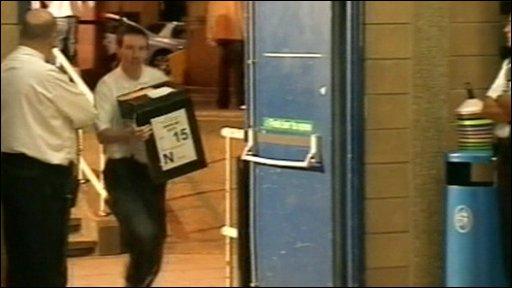 Runner carrying ballot box
