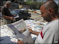 Baghdad resident reads a newspaper
