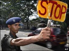 A Sri Lankan soldier orders a vehicle to stop at a checkpoint in Colombo on May 4, 2010