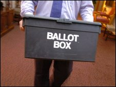 Man carrying a ballot box