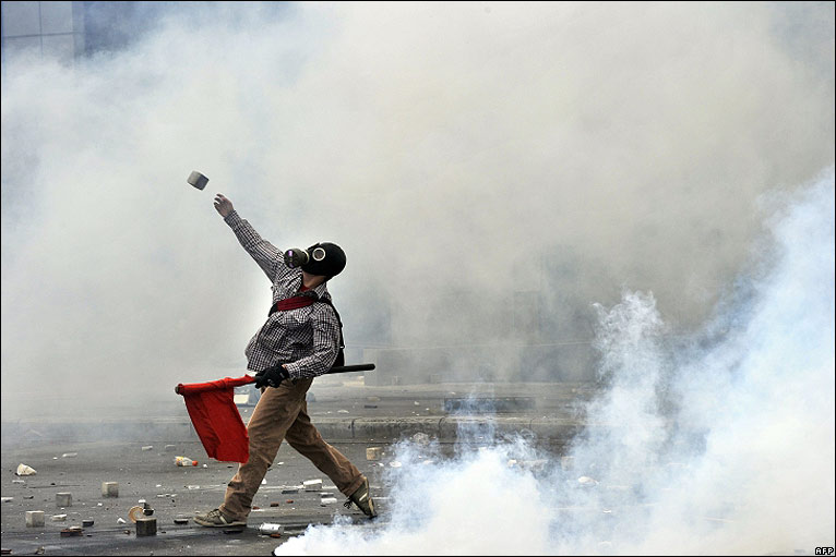 Protester throwing rock