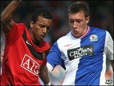Phil Jones challenges Manchester United's Nani