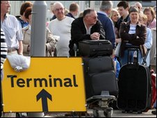 Passengers at Glasgow Airport waiting for coaches to take them to other UK airports on Wednesday 5 May 2010