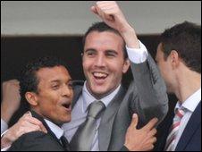 Man Utd players Nani and John O'Shea celebrate a winner