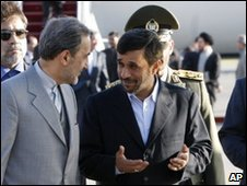 Iranian President Mahmoud Ahmadinejad speaks to advisers on his return to Tehran