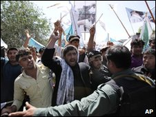 Afghan Protesters shout slogans agains Iran on 1 May 2010