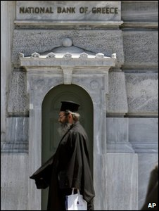 Greek Orthodox priest outside the National Bank of Greece