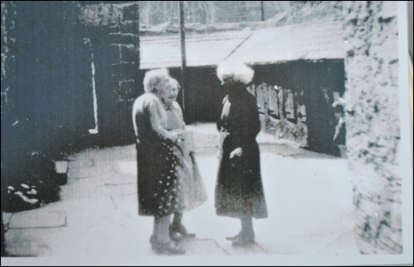 Ladies chat in the Almshouses courtyard