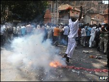 People celebrate the death penalty sentencing of Mohammed Ajmal Amir Kasab by setting off firecrackers