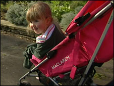 Emilie Hutchings in her pushchair