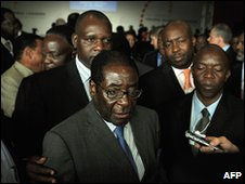 President of Zimbabawe Robert Mugabe (C) speaks to the press on May 6, 2010 at the World Economic Forum on Africa held in the Tanzanian commercial capital of Dar es Salaam