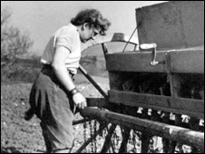 Jean Proctor checking that the seed spouts are running and not blocked on the farm