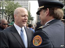 Mayor Mitch Landrieu greets a police officer at his inauguration ceremony