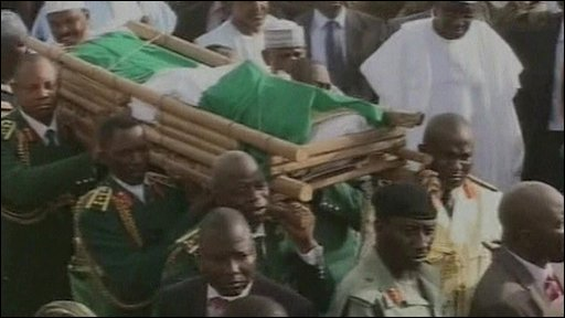 Pallbearers carry the body of President Yar'Adua
