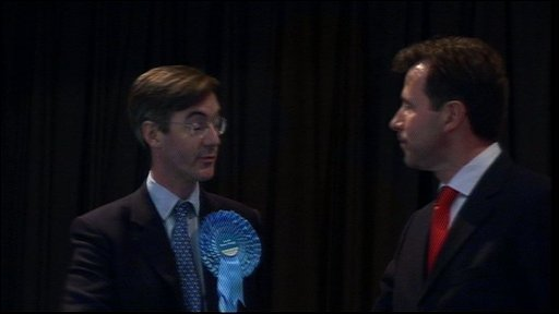 Jacob Rees-Mogg shakes hands with Dan Norris
