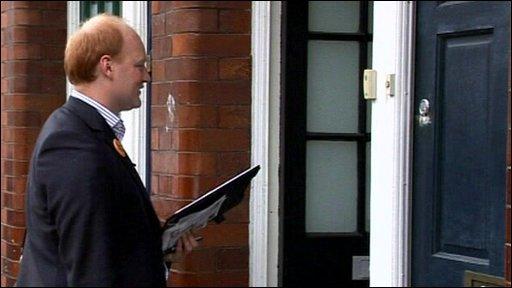 Party activist knocking on door
