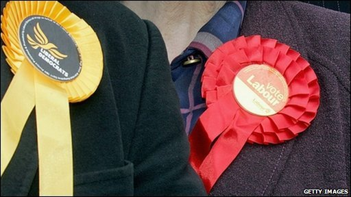 Liberal Democrat and Labour rosettes