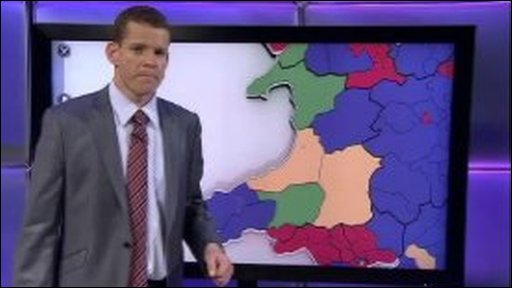 Rhun ap Iorwerth looks at a political map of Wales