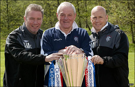 The Rangers management team pose with the SPL trophy