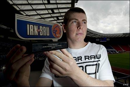 Clyde midfielder Connor Stevenson with his Irn Bru award