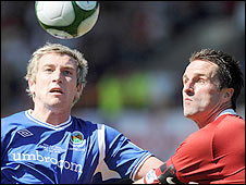 Linfield striker Mark McAllister in action against Portadown's Darren Kelly