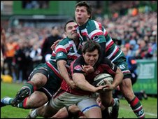 Schalk Brits of Saracens is tackled by Leicester's Jeremy Staunton and Ben Youngs