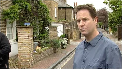 Lib Dem leader Nick Clegg outside his home
