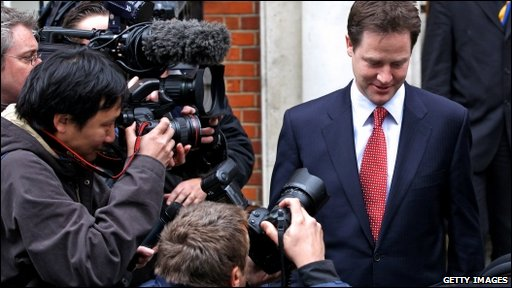 Liberal Democrat leader Nick Clegg surrounded by photographers